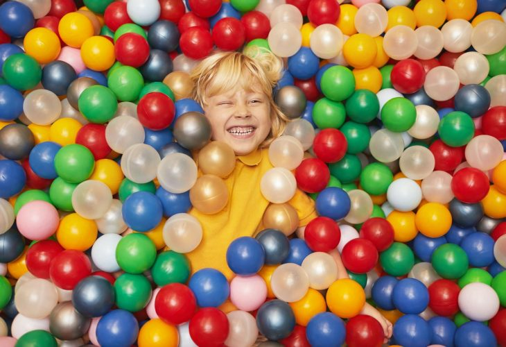 Boy in pool with balls